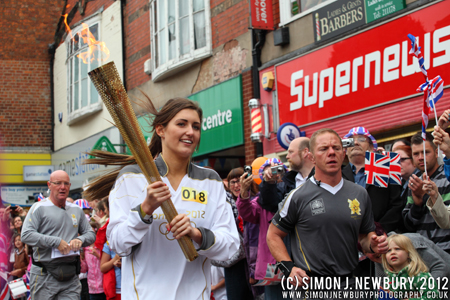 Charlotte Bradbury carrying the Olympic Torch through Crewe, Cheshire