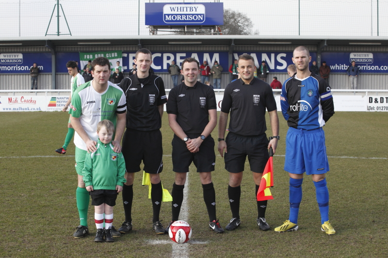 Adam as mascot at Nantwich Town FC with the Officials and team Captains
